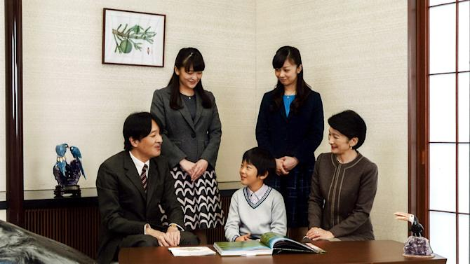 Japan's Prince Akishino smiles with his wife Princess Kiko and their children  at their residence in Tokyo