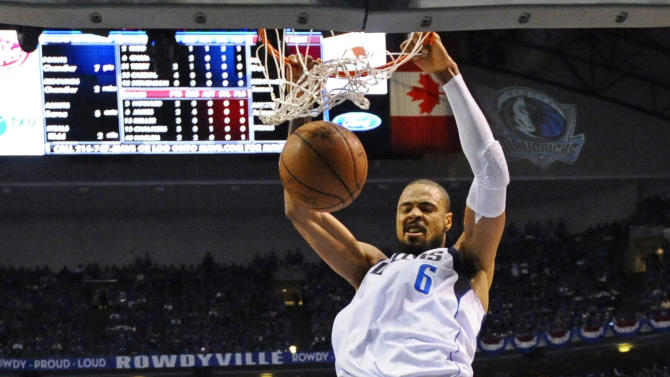 Dallas Mavericks' Tyson Chandler (6) dunks over Miami Heat's LeBron James (6) during the first half of Game 5 of the NBA Finals basketball game Thursday, June 9, 2011, in Dallas. (AP Photo/Larry W. Smith; Pool)