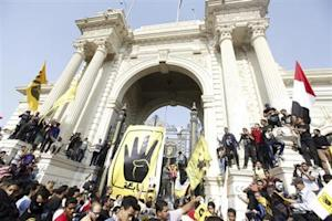 Muslim Brotherhood supporters gather in front of Qubba Palace in Cairo