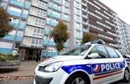 A police car drives past a building where a man was shot and fatally wounded while being arrested in connection with an anti-terrorist operation in Strasbourg, eastern France. The man shot dead by French police was linked to an attack on a Jewish store last month, Paris prosecutor Francois Molins said