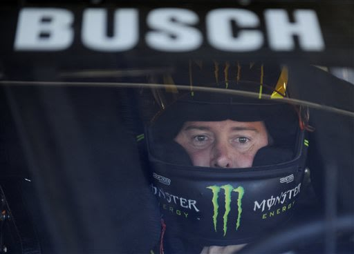 Kyle Busch waits in his car before practice for Sunday's NASCAR Sprint Cup series Coca-Cola 600 auto race at Charlotte Motor Speedway in Concord, N.C., Saturday, May 25, 2013