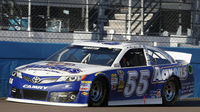 Mark Martin drives his car for a top speed during qualifying for the NASCAR Sprint Cup auto race Friday, March 1, 2013, in Avondale, Ariz.  With the fastest lap time Martin earned the pole position for the Sunday auto race.(AP Photo/Ross D. Franklin)
