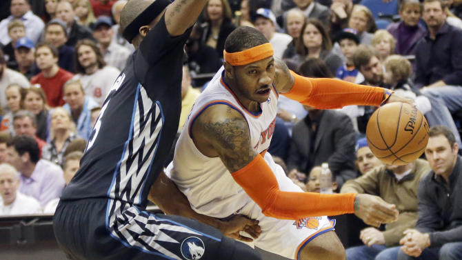 FILE - In this March 5, 2014, file photo, New York Knicks' Carmelo Anthony, right, leaves the floor as he drives around Minnesota Timberwolves' Dante Cunningham in the second half of an NBA basketball game in Minneapolis. A person with knowledge of the plans says the Knicks plan to meet with Anthony on Thursday, July 3, 2014, in Los Angeles. Anthony was in Los Angeles to meet with the Lakers, who are among the teams hoping to convince the All-Star forward to leave New York. (AP Photo/Jim Mone, File)