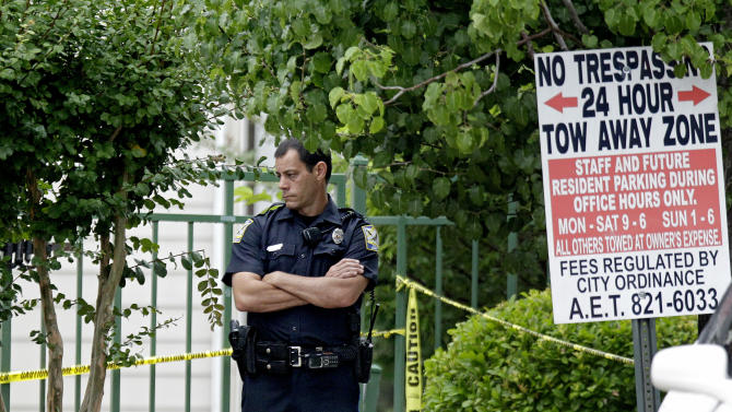 A police officer stands guard at the scene of an overnight shooting at an apartment complex Sunday, June 10, 2012, in Auburn, Ala. Auburn Police Chief Tommy Dawson said authorities responded during the night to a report of multiple gunshot victims at the apartment complex, but he released no immediate information early Sunday. (AP Photo/David Goldman)