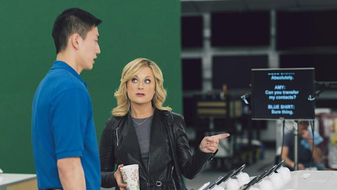 "This undated image provided by Best Buy, shows Amy Poehler on the set of the Company's Super Bowl commercial.  Best Buy's 30-second ad in the first quarter stars Amy Poehler, star of NBC's ""Parks and Rec,"" asking a Best Buy employee ""lots of questions."" (AP Photo/Best Buy)"
