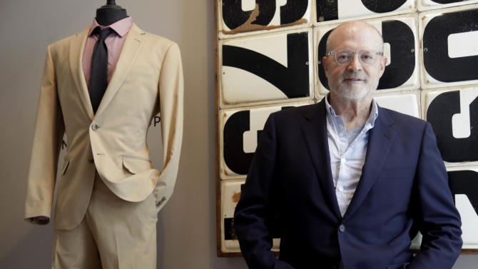 "This Aug. 8, 2012 photo shows J. Crew CEO Millard ""Mickey"" Drexler posing for a picture at a J. Crew store in New York. Under his leadership, J. Crew has carved out a place in the fashion hierarchy that's just between trendsetter and accessible, and Drexler seems to like living in that space. (AP Photo/Seth Wenig)"