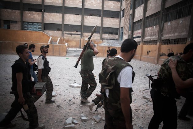 FSA soldiers go to the front line in Izaa district in Aleppo, Syria, Sunday, Sept. 9, 2012. On Friday, U.S. Senators John McCain, Joe Lieberman and Lindsay Graham, who have toured the volatile Middle East in recent days, urged Washington to help arm Syria&#39;s rebels with weapons and create a safe zone inside the country for a transition government. (AP Photo/ Manu Brabo)