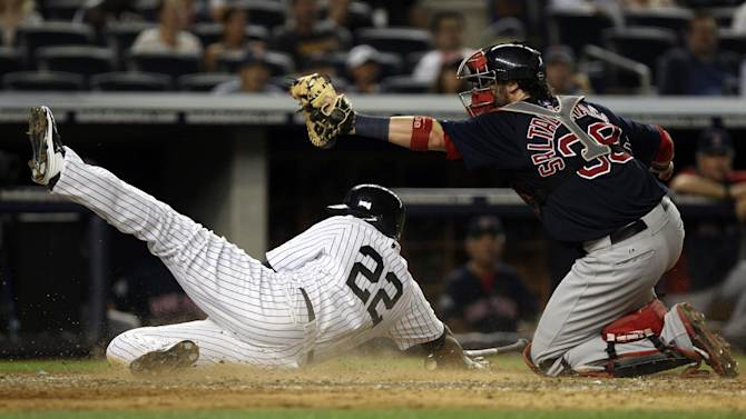 Boston Red Sox catcher Jarrod Saltalamacchia, right, tags out New York Yankees' Andruw Jones at home plate during the eighth inning of a baseball game at Yankee Stadium in New York, Friday, July 27, 2012. The Yankees defeated the Red Sox 10-3. (AP Photo/Seth Wenig)