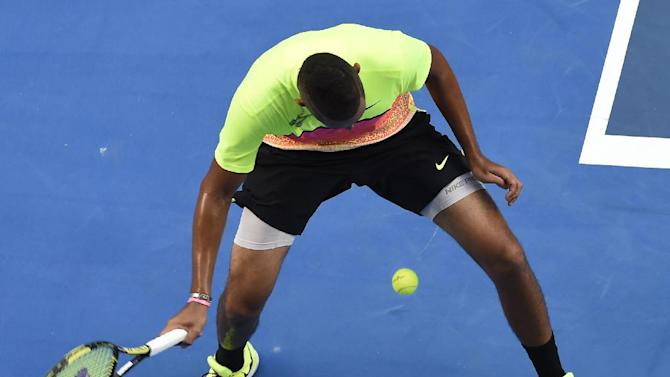 Nick Kyrgios of Australia makes a shot from between legs as he plays Andreas  Seppi of Italy during their fourth round match at the Australian Open tennis championship in Melbourne, Australia, Sunday, Jan. 25, 2015. (AP Photo/Andy Brownbill)