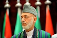 Afghan President Hamid Karzai attends the Organisation of the Islamic Conference in Mecca in August. Zhou Yongkang&#39;s appearance in Kabul comes after Karzai pledged to work with China to fight terrorism and extremism in the region