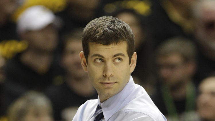 Butler head coach Brad Stevens watches his team during the second half of an NCAA college basketball game against Virginia Commonwealth in Richmond, Va., Saturday, March 2, 2013.  VCU won 84-52.  (AP Photo/Steve Helber)