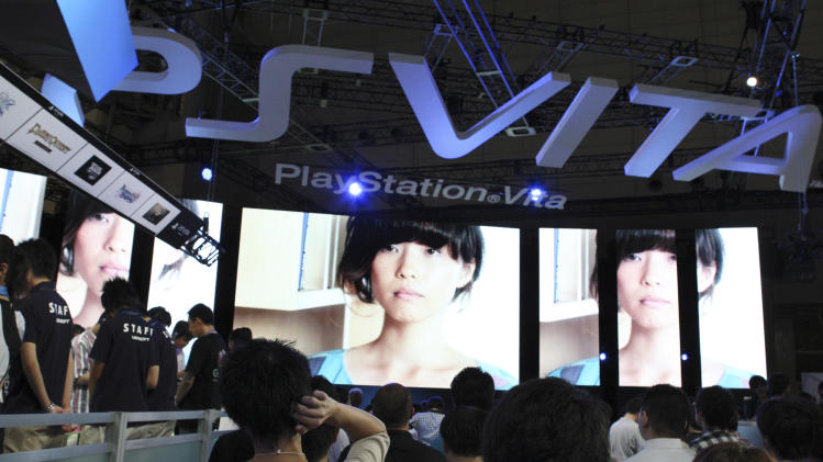 FILE - In this Sept. 15, 2011 file photo, visitors crowd at the booth of Sony Computer Entertainment for a new portable machine, PlayStation Vita, at the Tokyo Game Show in Chiba, east of Tokyo. Sony's long-awaited PlayStation Vita portable game machine hits stores in Japan on Saturday Dec. 17 with the company predicting brisk sales even though the launch has missed much of the holiday shopping season. (AP Photo/Koji Sasahara, File)