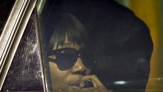 Zindzi Mandela, one of the daughters of former South African president Nelson Mandela, leaves the Mediclinic Heart Hospital where Mandela is being treated in Pretoria, South Africa, Saturday, June 15, 2013. Relatives of Nelson Mandela have visited the former South African president in a hospital where he is being treated for a lung infection. (AP Photo/Ben Curtis)