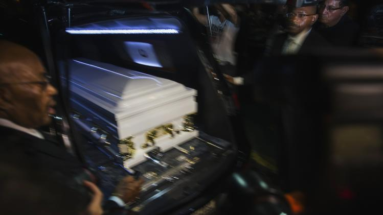 Pallbearers look at the casket of Garner as it rests in a hearse following his funeral in New York