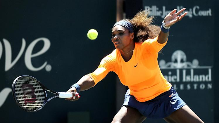 Serena Williams stretches for a forehand return during her semifinal match against her sister Venus Williams at the Family Circle Cup tennis tournament in Charleston, S.C., Saturday, April 6, 2013. Serena won 6-1, 6-2. (AP Photo/Stephen Morton)