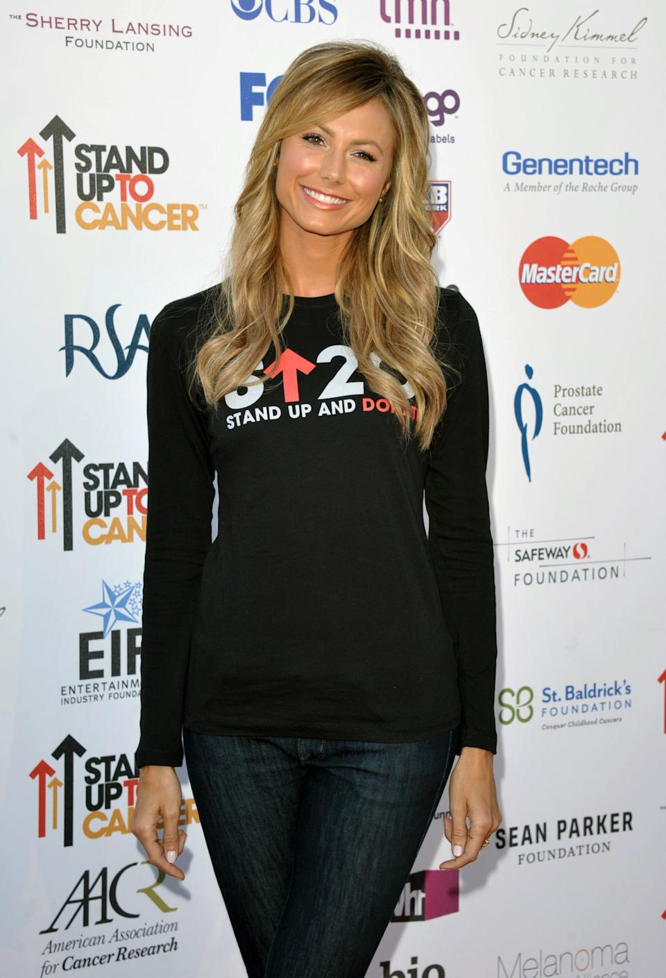 "Actress Stacy Keibler attends the ""Stand Up to Cancer"" event at the Shrine Auditorium on Friday, Sept. 7, 2012 in Los Angeles. The initiative aimed to raise funds to accelerate innovative cancer research by bringing new therapies to patients quickly.  (Photo by John Shearer/Invision/AP)"