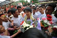 Aung San Suu Kyi (C) is greeted by supporters as she arrives for the opening ceremony of the Hlaing township National League for Democracy office in Yangon in May. There is concern about how the party can meet the enormous hopes and expectations of Myanmar's long-suffering people