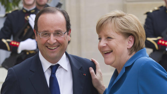 French President Francois Hollande, left, welcomes German Chancellor Angela Merkel at the Elysee Palace, Wednesday, June 27, 2012. Germany's Chancellor Angela Merkel says she hopes European leaders adopt a €130 billion ($162 billion) stimulus package this week, in a gesture to French President Francois Hollande despite their differences over how to end Europe's spiraling debt crisis. The two leaders went into talks Wednesday night sharply opposed over whether to share debt among the 17 nations that use the euro, and how much sovereignty to surrender over national budgets. (AP Photo/Michel Euler)