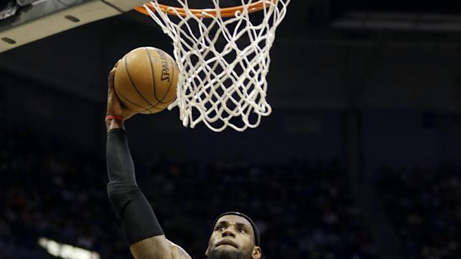 Miami Heat's LeBron James dunks against the Milwaukee Bucks during the first half of Game 4 in a first-round NBA basketball playoff series, Sunday, April. 28, 2013, in Milwaukee. (AP Photo/Jeffrey Phelps)