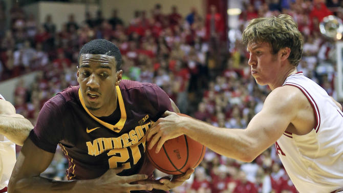 Indiana's Jordan Hulls (1) knocks the the ball away from Minnesota's Austin Hollins (20) by during the first half of an NCAA college basketball game, Saturday, Jan. 12, 2013, in Bloomington, Ind. (AP Photo/Darron Cummings)
