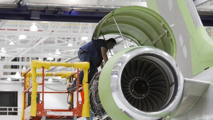 A worker looks at an engine on a Bombardier Global 5000 jet as its being assembled at the Bombardier aircraft manufacturing facility in Toronto