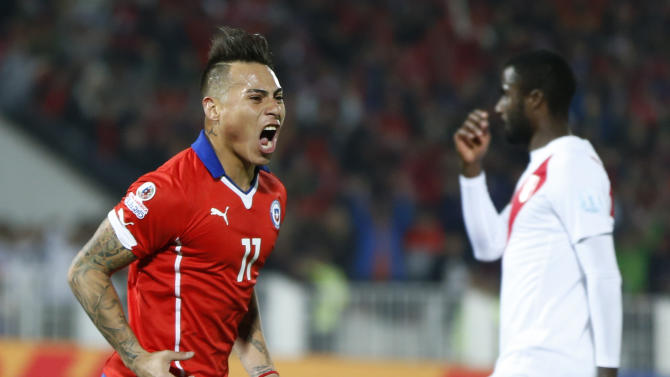 Chile's Eduardo Vargas, left, celebrates after scoring against Peru during a Copa America semifinal soccer match at the National Stadium in Santiago, Chile, Monday, June 29, 2015. (AP Photo/Andre Penner)