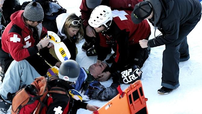 Simon d'Artois, of Canada, is aided by emergency personnel after he crash during the halfpipe freestyle skiing competition at the U.S. Grand Prix, Saturday, Feb. 2, 2013, in Park City, Utah (AP Photo/George Frey)
