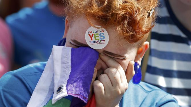 A same-sex marriage supporter reacts at Dublin Castle in Dublin