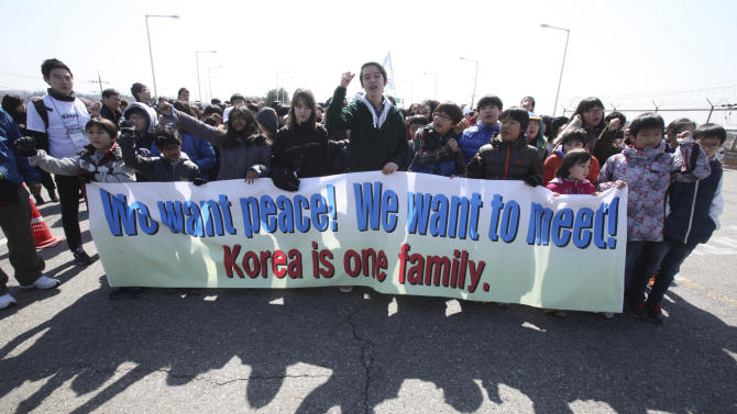Children shout slogans during a rally to promote peace on the Korean peninsula at the Unification Bridge near the border village of Panmunjom in Paju, South Korea,Thursday, March 21, 2013. North Korea has threatened revenge for the sanctions and for ongoing U.S.-South Korean military drills, which the allies describe as routine but which Pyongyang says are rehearsals for invasion. (AP Photo/Ahn Young-joon)