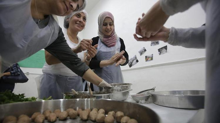 Syrian refugee women prepare regional dishes at Caritas Lebanon Immigrants Centre in Beirut on November 6, 2013