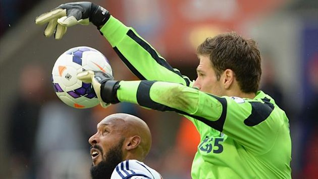 Asmir Begovic of Stoke City goes up for a high ball with Nicolas Anelka of West Brom (Getty Images)