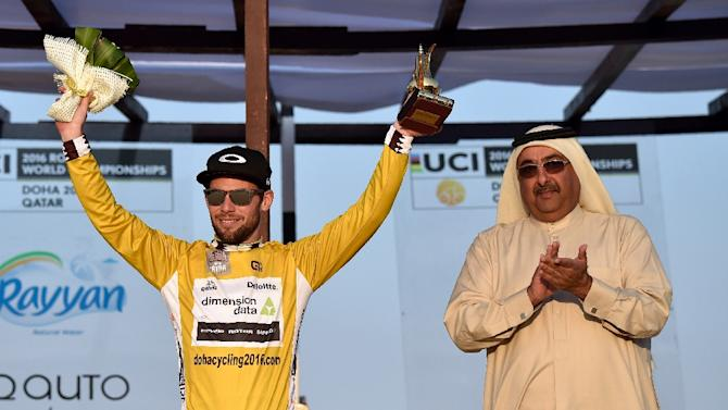 Britain's Mark Cavendish (L) of Dimension Data team celebrates his overall gold jersey on the podium of the fifth and last stage of the 15th Tour of Qatar in Qatar on February 12, 2016