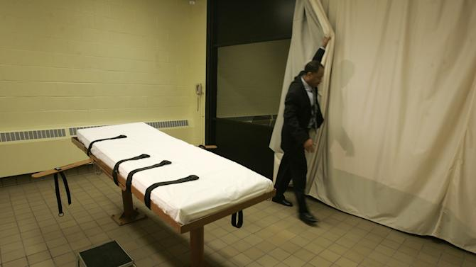 """FILE - In this Nov. 2005 file photo, public information director Larry Greene is shown in the death chamber at the Southern Ohio Correctional Facility in Lucasville, Ohio. Ohio prison officials said Friday, Oct. 4, 2013, they are keeping their primary lethal injection drug in place despite the state's supply expiring, but they've added a second drug option for executioners to address the shortage. Prisons spokeswoman JoEllen Smith said the powerful sedative pentobarbital will remain Ohio's primary method of administering the death penalty. A policy posted to the prisons department's website listed a combination of midazolam and hydromorphone as an alternative if sufficient pentobarbital isn't available or if the existing supply """"is deemed unusable"""" by the medical team. (AP Photo/Kiichiro Sato, File)"""