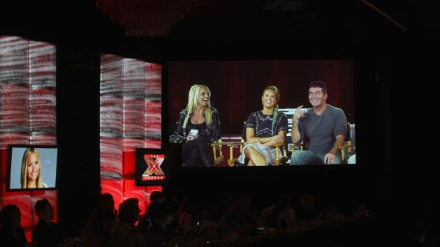 Judges Britney Spears, Demi Lovato and Simon Cowell speak via satellite at 'The X Factor' panel during day 3 of the FOX portion of the 2012 Summer TCA Tour held at the Beverly Hilton Hotel on July 23, 2012 -- Getty Images