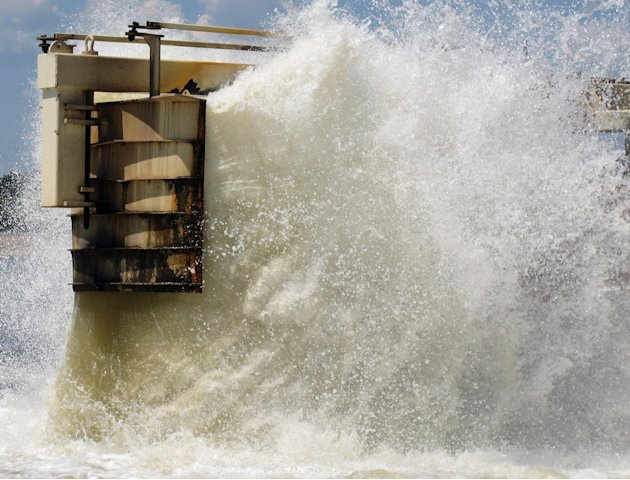 Water gets churned up at the end of a dredging pipeline connected to a U.S. Army Corps of Engineers' dredge on the Mississippi River on Monday, Aug. 20, 2012 near Memphis, Tenn. Sand that is removed f