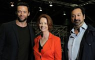 Actor Hugh Jackman (L), Australian Prime Minister Julia Gillard (C), and US director James Mangold at the set of the movie 'The Wolverine' in July. Gillard said it was Jackman himself who convinced her to provide the money to bring the film's production to Australia because it would create more than 2,000 jobs and keep specialist skills in the country