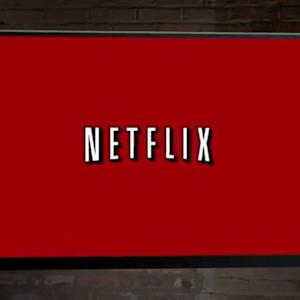 NETFLIX PAYS TWC FOR FASTER SPEEDS
