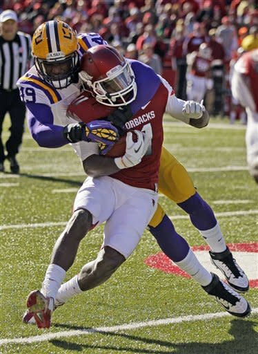 Landry, No. 8 LSU hold off Arkansas 20-13