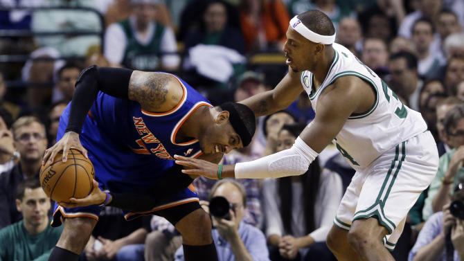 New York Knicks forward Carmelo Anthony, left, makes a move against the defense of Boston Celtics forward Paul Pierce during the first half in Game 4 of a first-round NBA basketball playoff series in Boston, Sunday, April 28, 2013. (AP Photo/Elise Amendola)