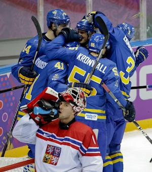 Karlsson leads Sweden past Czechs in hockey opener