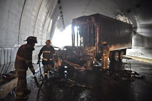 Firemen put out the fire after a truck was set ablaze …