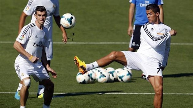 Real Madrid's Gareth Bale (L) and Cristiano Ronaldo challenge for the ball during their training session (Reuters)
