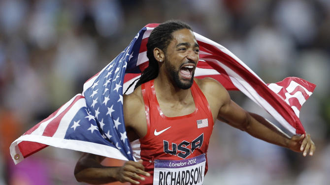 United States' Jason Richardson celebrates winning silver in the men's 110-meter hurdles final during the athletics in the Olympic Stadium at the 2012 Summer Olympics, London, Wednesday, Aug. 8, 2012. (AP Photo/Ben Curtis)