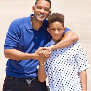 Will Smith poses with his son and co-star Jaden Smith outside the main entrance of Spaceport America the 'After Earth' press junket on May 17, 2013 -- Getty Premium