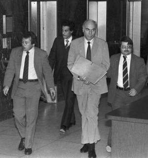 FILE - In this Jan. 22, 1983 file photo, ex-CIA agent Edwin Wilson, center, leaves federal court after a day of jury selection accompanied by U.S. Marshals in Houston. Edwin P. Wilson, a former CIA operative who was branded a traitor and convicted of shipping arms to Libya but whose conviction was later overturned after he served 22 years in prison, has died, Sept. 10, 2012. He was 84. (AP Photo/File)