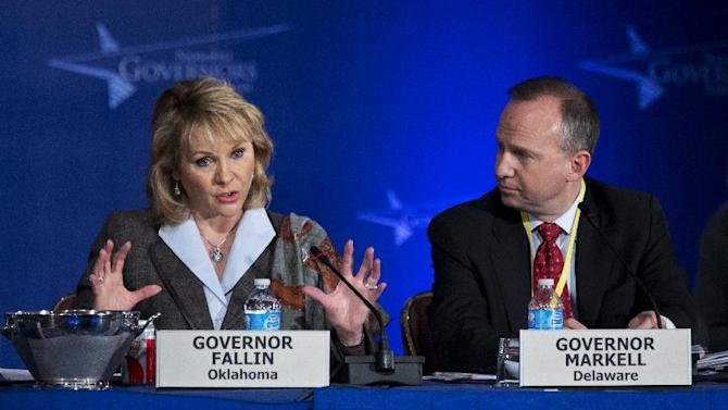 National Governors Association Vice Chairman Gov. Mary Fallin of Oklahoma, left, with Chairman Gov. Jack Markell of Delaware, speaks during a special session of the National Governors Association 2013 Winter Meeting in Washington, Sunday, Feb. 24, 2013. Governors Sunday roundly condemned the automatic budget cuts set to take hold this week, and hoped for a deal to stave off the $85 billion reduction in government services. (AP Photo/Manuel Balce Ceneta)