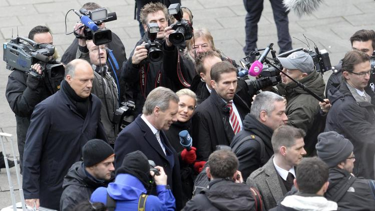 Former German President Wulff is surrounded by media as he arrives at the regional court in Hanover,