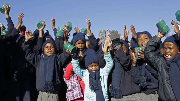 Children sing happy birthday in honour of  former South African President Nelson Mandela during celebrations for Mandela's birthday in Mvezo, South Africa, Wednesday, July 18, 2012. Across the country, and even abroad, people are doing good deeds to honor the country's most famous statesman on his 94th birthday today. (AP Photo/Schalk van Zuydam)
