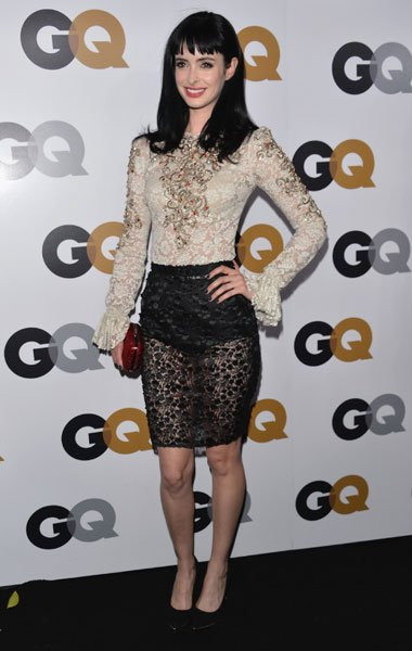 Krysten Ritter: Is Ritter trying to copy Kristen Stewart's vampy lacy look? The actress wows in a sexy Dolce & Gabbana ensemble with a cream blouse that features red and gold embelishments and a sheer