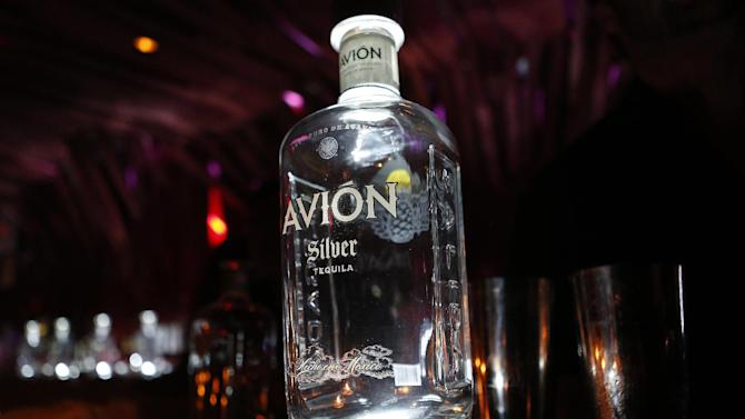 IMAGE DISTRIBUTED FOR ATHLETES QUARTERLY - A bottle of Avion tequila rests on the bar at The Athletes Quarterly Avion Lounge event at Tenjune in the meat packing district, Tuesday, April 23, 2013, in New York City, New York. (John Minchillo/AP Images for Athletes Quarterly)